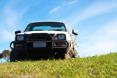 Four wheel drive. A four wheel drive parked on top of a grassy bank Royalty Free Stock Image