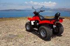 Four wheel drive. Red and black quad bike Royalty Free Stock Photography