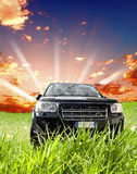 Four-wheel drive car. On country track in morning Royalty Free Stock Image