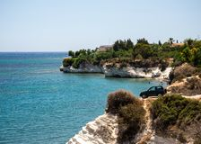 A four wheel drive car dangerously parked next to steep cliff at Governor`s beach, Cyprus. A four wheel drive car dangerously parked next to steep cliff at Royalty Free Stock Photos