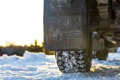 Four wheel drive car splash guard in Finland. In the background a snowy and sunny landscape Royalty Free Stock Photos