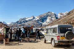 Four wheel drive cars parking area with tourists and floating market with Yunthang Valley in the background in winter. Royalty Free Stock Image