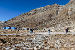 Four wheel drive cars parking area with tourists and market with Yunthang Valley in the background in winter in Zero Point. Stock Images
