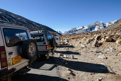Four wheel drive cars parking area with Yunthang Valley in the background in winter in Zero Point at Lachung. North Sikkim, India Royalty Free Stock Photos