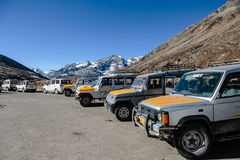Four wheel drive cars parking area with Yunthang Valley in the background in winter in Zero Point at Lachung. North Sikkim, India Royalty Free Stock Images