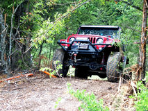 Four Wheel Drive. A Four Wheel Drive cresting the top of a trail in a four wheel drive park located in Southern Oklahoma in the United States Stock Images