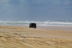Four Wheel Drive on 75 Mile Beach. Four wheel drive vehicle on 75 mile beach, Fraser Island, Australia Royalty Free Stock Images