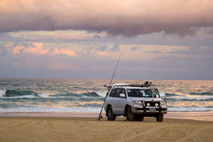 Four Wheel Drive on 75 Mile Beach. Four wheel drive vehicle on 75 mile beach, Fraser Island, Australia, with fishing rod Stock Images