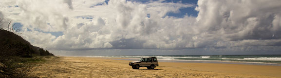 Four Wheel Drive on 75 Mile Beach. Four wheel drive vehicle on 75 mile beach, Fraser Island, Australia, panorama Royalty Free Stock Images