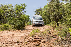 Four-wheel drive Mitsubishi Triton is doing off- road. Royalty Free Stock Photography
