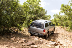 Four-wheel drive Mitsubishi Triton is doing off- road. Stock Image