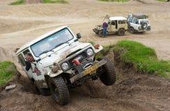 Four wheel drive on muddy track Stock Photo