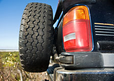 Four wheel drive tailgate with tyre. With landscape scenery Stock Photo