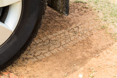 Four wheel drive tire with tracks on dry dirt road Royalty Free Stock Photo