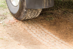 Four wheel drive tire with tracks on dry dirt road Royalty Free Stock Photos