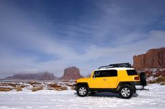 Four Wheel Drive Touring in Mountain Snow. Four wheel drive vehicle on tour in the mountains. Off road driving is a popular outdoors activity. Image taken in the Stock Photography