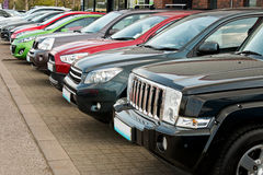 Four wheel drive utility vehicles for sale. Row of used four by four motorcars also known as 4x4, SUV, off road, utility vehicle, ute or Station wagon arranged Stock Image