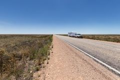 Four wheel drive vehicle and large caravan parked by the side of outback highway. Four wheel drive vehicle and large caravan parked by the side of the highway Royalty Free Stock Photo