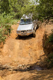 Four-wheel drive vehicle Toyota Hilux is doing off-road. Stock Image