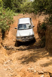 Four-wheel drive vehicle Toyota Hilux is doing off-road. Stock Images