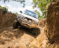 Four-wheel drive vehicle Toyota Hilux is doing off-road. Royalty Free Stock Photography
