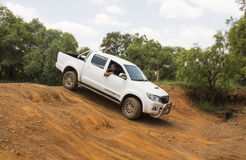 Four-wheel drive vehicle Toyota Hilux Legend 45 is doing off-road. South Africa, Gauteng, Hennops off-road trail - 06 February, 2016. Four-wheel drive vehicle Royalty Free Stock Images