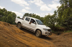 Four-wheel drive vehicle Toyota Hilux Legend 45 is doing off-road. Stock Photo
