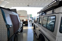 Four wheel drive vehicles on ferry over to Fraser Island Queensland Australia stock image