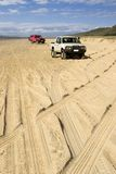 Four-wheel driving on Fraser Island. 4WD tracks on beach highway Royalty Free Stock Image