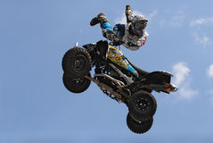 Four-wheel motorcycle. Biker on four-wheel motorcycle Royalty Free Stock Images