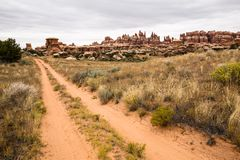 Four wheel trail through sandstone pinnacles of Southern Utah. A 4x4 road runs through sagebrush and sandstone towers and spires of hte desert of southern Utah Stock Photography