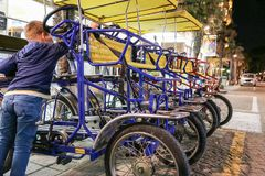 Four-wheeled bicycles in the parking lot, Italy, Riccione royalty free stock images