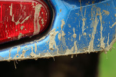 Four wheeling. Close up of the rear of a blue four wheeler covered in mud Royalty Free Stock Photos
