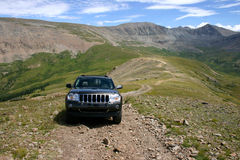 Four Wheeling Colorado. SUV parked on a 4wd trail in the high mountains above timberline in Colorado off of Mosquito Pass Royalty Free Stock Images
