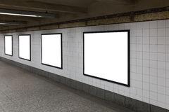 Four white blank billboards in the tunnel. Royalty Free Stock Image