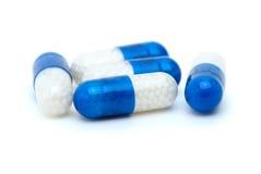 Four white-blue pills Royalty Free Stock Photo