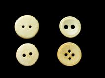 Four white buttons. Assorted buttons on black background Royalty Free Stock Image