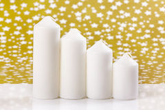 Four white candles Royalty Free Stock Image