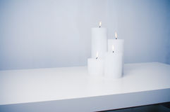 Four white candles burning Stock Images