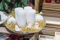 Four white candles on the plate with angels Stock Photography