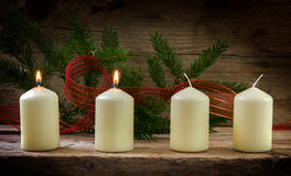 Four white candles, two of them burning on the second advent, de Stock Photo