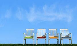 Four   white chair on grass Stock Photo