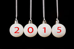 Four white christmas balls with year 2015 Stock Photography