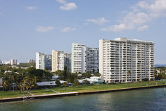 Four White Condo Buildings on Coast Royalty Free Stock Images