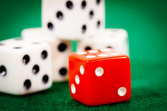 Four White Dice One Red Royalty Free Stock Photography