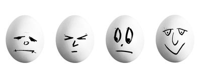 Four white eggs with face Royalty Free Stock Photo