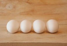 Four white eggs Stock Photo