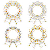 Four white and gold rosettes Stock Photos