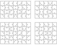 Four white puzzles Royalty Free Stock Images