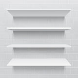 Four white realistic shelves against brick wall Stock Photography